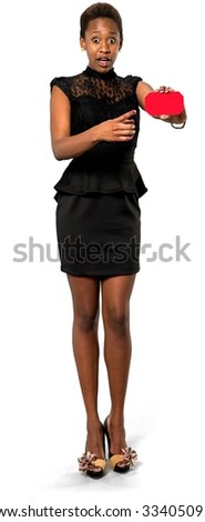 Shocked African young woman with short dark brown hair in evening outfit holding business card - Isolated - stock photo