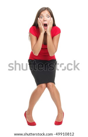 Shocked and surprised businesswoman isolated in full length. Beautiful mixed race caucasian / chinese young woman standing with open mouth holding her head in surprise. Isolated on white background. - stock photo