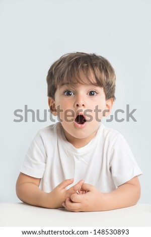 Shocked and surprised little one is about to scream with joy. - stock photo
