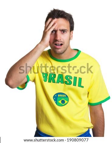 Shocked brazilian soccer fan - stock photo