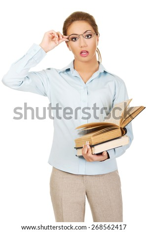 Shocked business woman holding a book. - stock photo