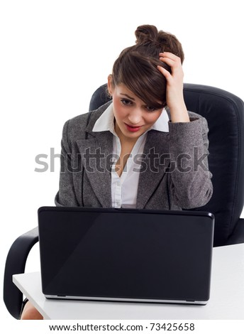 shocked business woman in front of laptop - stock photo