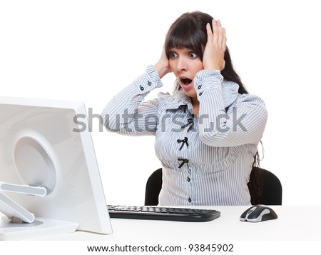 shocked businesswoman looking at monitor - stock photo