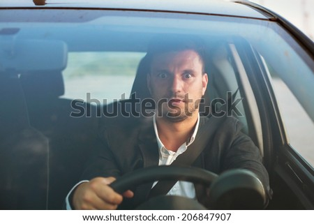 shocked driver in the car - stock photo