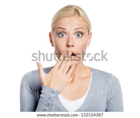 Shocked girl covers her opened mouth with hand, isolated on white - stock photo