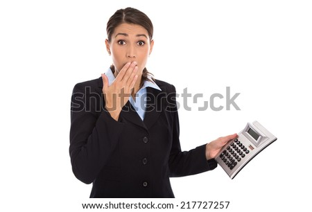 Shocked isolated businesswoman looking frustrated at pocket calculator. - stock photo