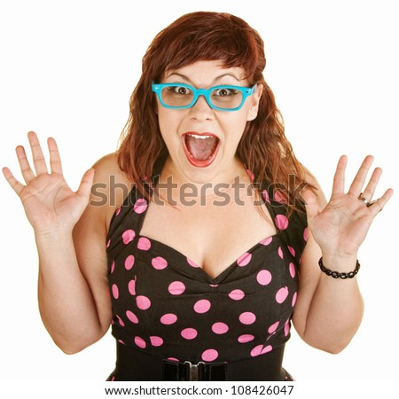 Shocked lady in blue eyeglasses with hands up - stock photo