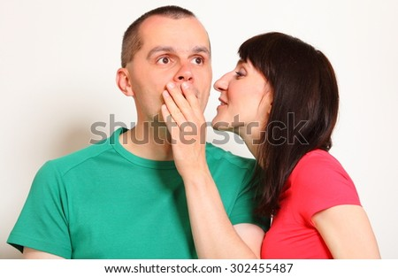 Shocked man receive an unexpected message from woman, hands covering mouth, face expression and human emotion  - stock photo