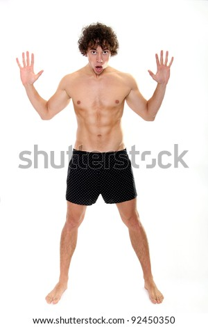 Shocked muscular young man-shirtless - stock photo