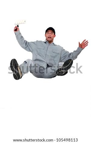 Shocked painter falling backwards - stock photo