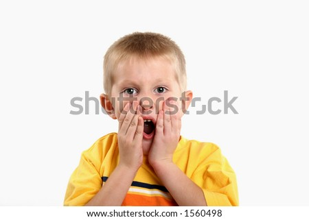 shocked/surprised kindergarten boy - stock photo