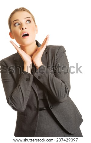 Shocked woman holding hands on chin. - stock photo