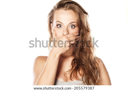 shocked young blonde on white background - stock photo