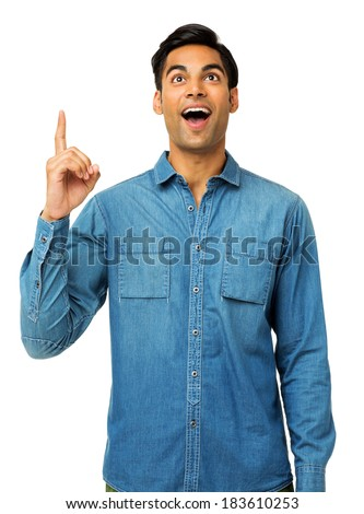 Shocked young man with an idea pointing upwards over white background. Vertical shot. - stock photo