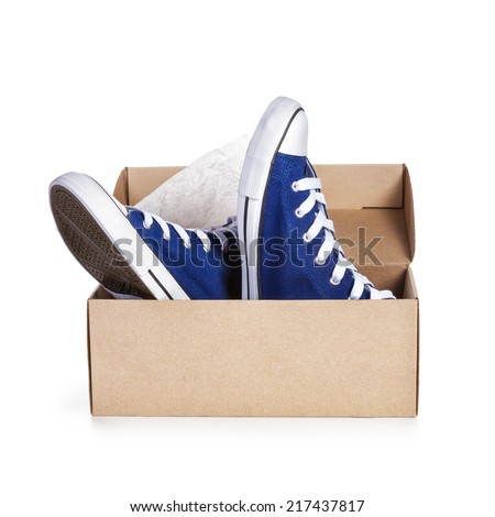 Shoe box with pair of new sneakers isolated on white background. Object with clipping path - stock photo