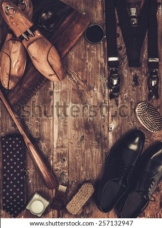 Shoe care and gentleman's accessories on a wooden table  - stock photo