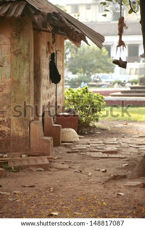 Shoe hanging from a tree, poor indian village - stock photo