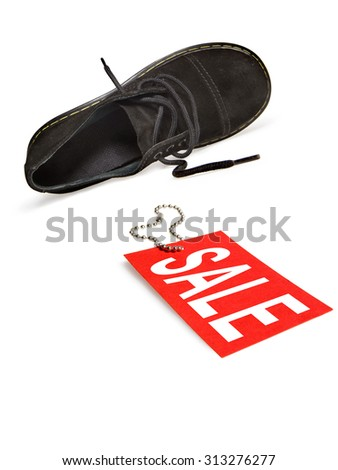 """Shoe lying on side with red sale sign. Studio isolated on white background. Image have clipping path. See photo """"Labels for retail"""" in my portfolio for other text label for this image. - stock photo"""