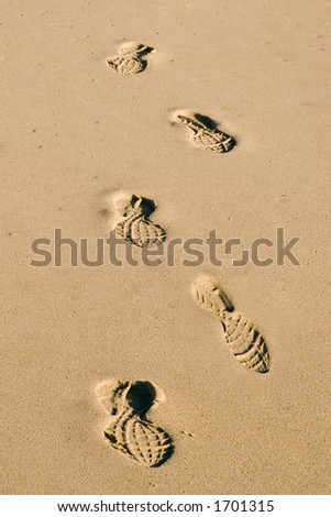 Shoe Prints on the beach - stock photo