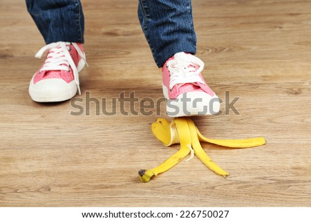 Shoe to slip on banana peel and have an accident - stock photo