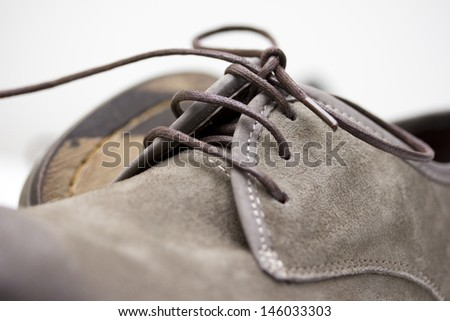 Shoelace Close-up on Brown Suede Leather Shoes - stock photo