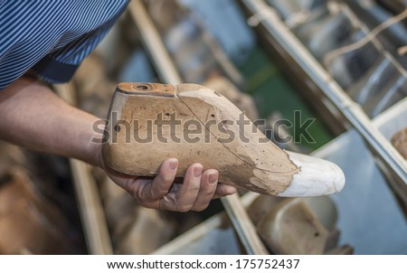 Shoemaker Is Repairing Boot-Tree. retro wooden shoe production - stock photo