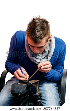 Shoemaker working on new heel for shoe - stock photo