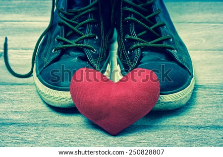 Shoes and red heart. Love theme - stock photo