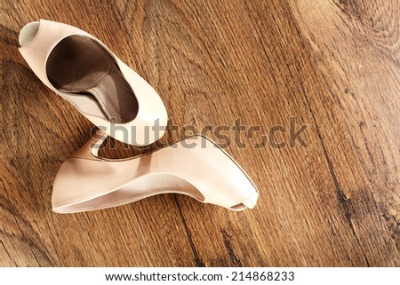 shoes and space on dark brown retro floor space  - stock photo