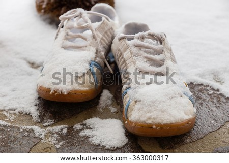 Shoes covered with fresh snow - stock photo