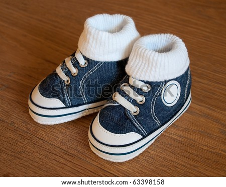 Shoes for Baby - Sneakers - on the wooden floor ... - stock photo