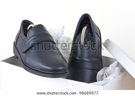 Shoes for men packed into a shoebox. - stock photo