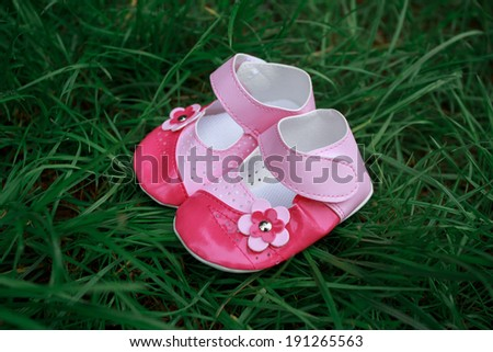 shoes for your little princess the first steps of a little girl shoes for Cinderella baby's bootees - stock photo