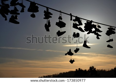 Shoes Hanging from Wire - stock photo