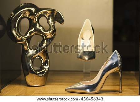 Shoes in a display window of a fashion store - stock photo