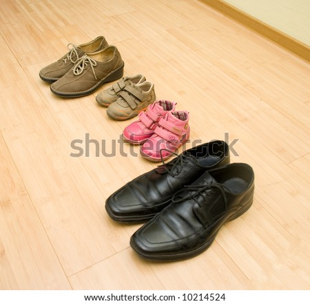 Shoes of family members - stock photo