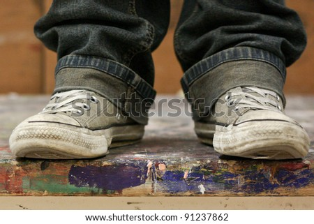 Shoes on colorful table - stock photo