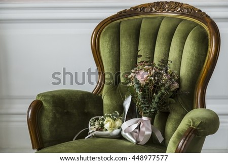 Shoes with a wedding bouquet of flowers on a chair - stock photo
