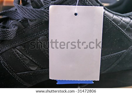 Shoes with white plain tag close up or macro. - stock photo