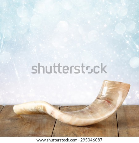 shofar (horn) on wooden table. rosh hashanah (jewish holiday) concept . traditional holiday symbol.  - stock photo