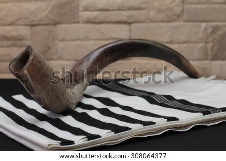 shofar (ram's horn)  and tallit  - rosh hashanah (jewesh holiday) concept - stock photo