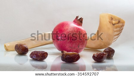 shofar  with a pomegranate and dates - stock photo