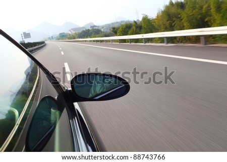 shoot from the window of rush car,motion blur road - stock photo