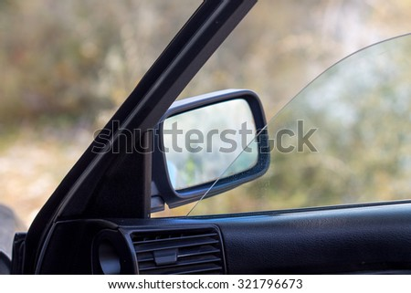 Shoot in rear-view mirror of car .  - stock photo