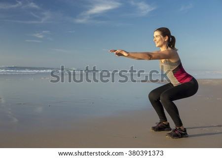 Shoot of a beautiful woman making squats exercises in the beach - stock photo