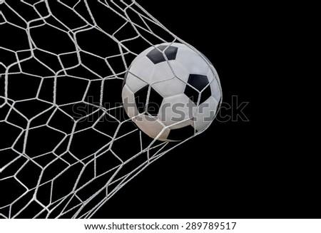 Shoot soccer ball in goal, net on black isolated background. - stock photo