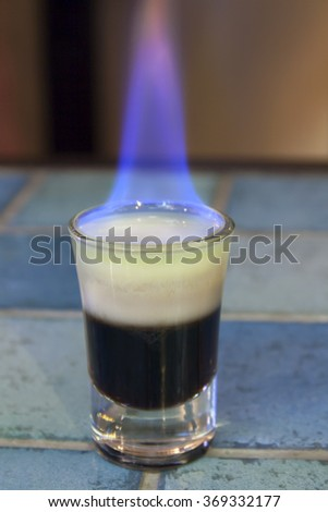 Shooter - B52 cocktail - layered and with the flame. - stock photo