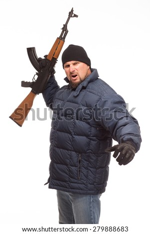 Shooter with AK 47  and cold weather gear ready to fight with determined look on his face on white background. - stock photo