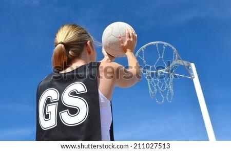 Shooting a Netball - stock photo