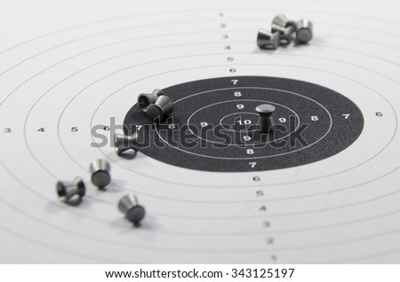 shooting from the pneumatic weapon to the target - stock photo